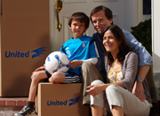 Family around moving boxes ready to move out of house