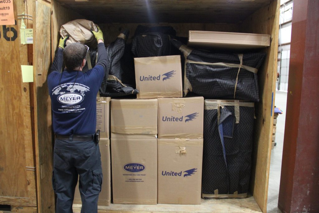 meyer movers loading boxes on a moving truck